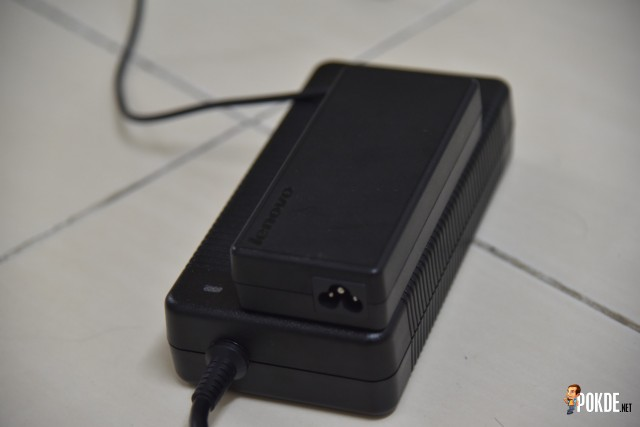 The massive 330W power adapter which feeds the Titan.